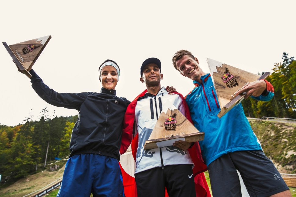 L-R) Second place winner Luka Kovacic (SLO), first place winner Ahmet Arslan (TUR) and third place winner Nejc Kuhar (SLO) celebrate at Red Bull 400 in Planica, Slovenia on September 19, 2015.